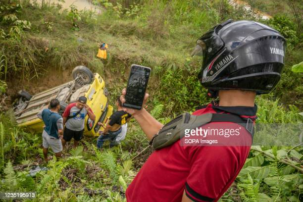 Resident takes a live video broadcast of the evacuation process for social media. A vehicle crashed down the ravine however no one sustained...