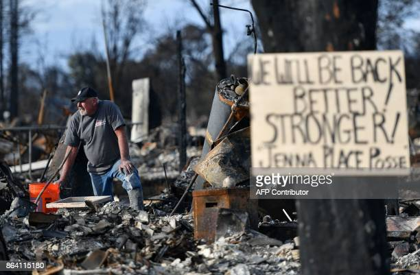 A resident takes pause while searching through debris at his burned home in Santa Rosa California on October 20 2017 Residents are being allowed to...