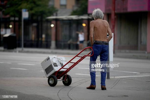 Resident transports an air conditioner on West Pender Street during a heatwave in Vancouver, British Columbia, Canada, on Monday, June 28, 2021. The...