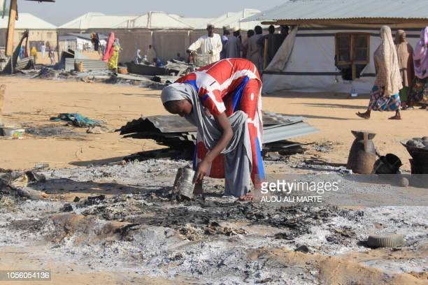 A resident tries to salvage valuables from burnt house following multiple attacks by Boko Haram Islamists at Dalori and other neighbouring villages...