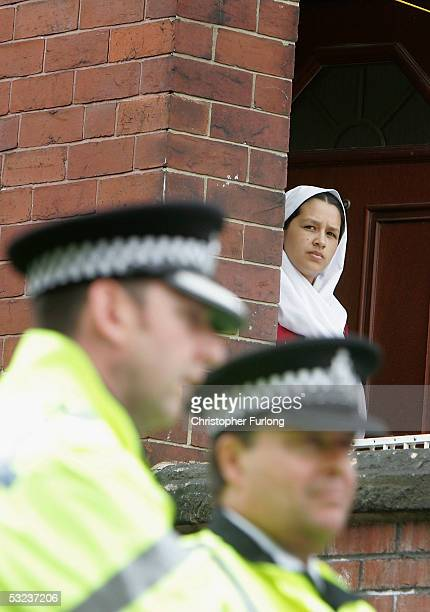 Resident waits for the all clear as army bomb disposal experts inspect a shop in Lodge lane, Beeston on July 14, 2005 in Leeds England. Police have...