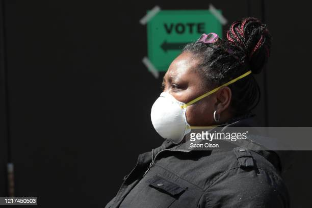 A resident waits in line to vote at a polling place at Riverside University High School on April 07 2020 in Milwaukee Wisconsin Residents waited...
