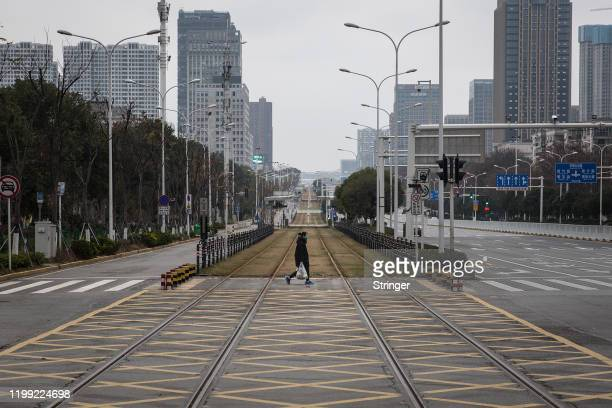 Resident walks across an empty track on February 7, 2020 in Wuhan, Hubei province, China. The number of those who have died from the Wuhan...