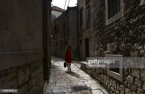 A resident walks along a street in the town of Sibenik located in the central area of the Dalmatia region Croatia on September 4 2018