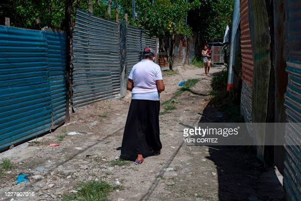Resident walks back to her home after a medical consultation at a clinic of the organization Doctors Without Borders installed at the December 1...