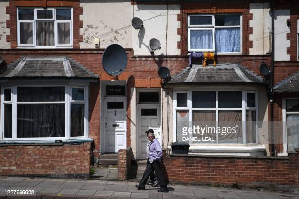 Resident walks in a street in the Highfields area of Leicester, central England on July 17 as local lockdown restrictions remain in force due to a...
