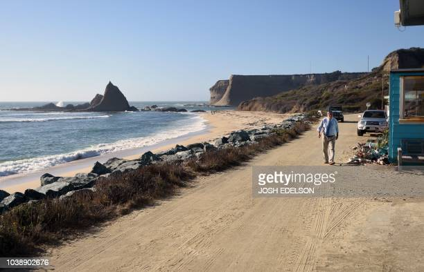 A resident walks in front of his home at Martin's Beach in Half Moon Bay California on September 19 2018 Billionaire Vinod Khosla purchased the land...