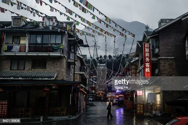 A resident walks in the town streets on 30th March 2018 in Yingxiu Ngawa Tibetan and Qiang Autonomous Prefecture Sichuan province China The town was...