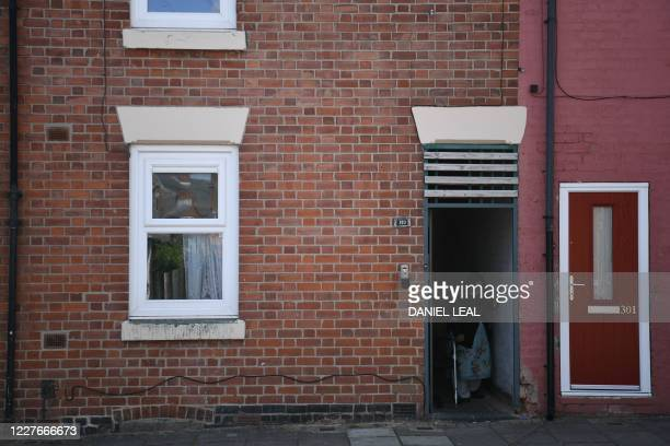 Resident walks out of a doorway in the Highfields area of Leicester, central England on July 17 as local lockdown restrictions remain in force due to...