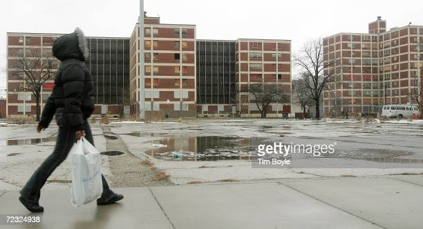 A resident walks past some of the few remaining Chicago Housing Authority CabriniGreen public housing buildings January 12 2005 in Chicago Illinois...