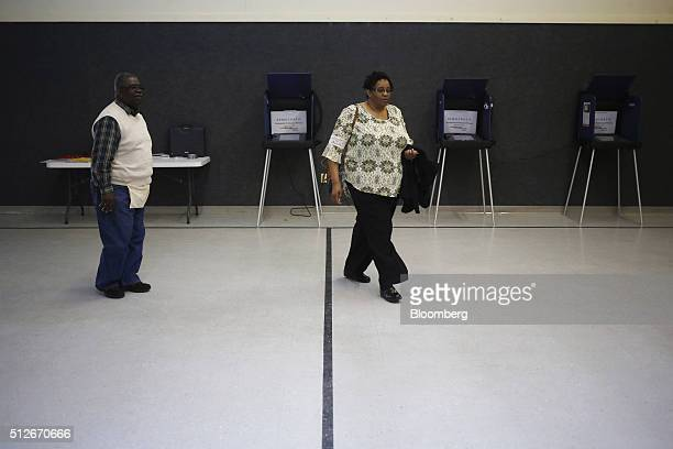 A resident walks toward the exit after voting in the South Carolina Democratic presidential primary election at a polling station inside the First...