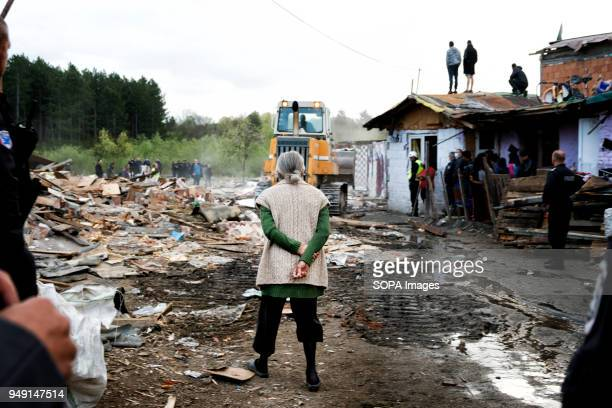 A resident watches as her home and others are razed in a Roma quarter of Sofia At least 20 homes deemed illegal were destroyed by the local...