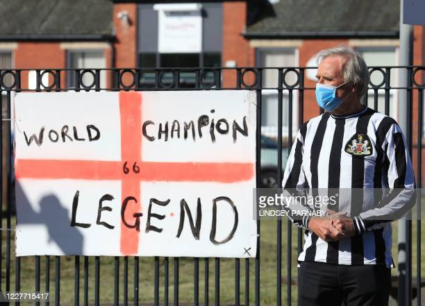 A resident wearing a Newcastle United shirt waits to pay his respects to Jack Charlton whose hearse will pass through the streets of his hometown...