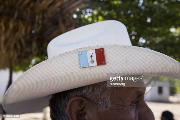 A resident wears a cowboy hat with a Yaqui tribe flag in the village of Loma de Bacum Sonora state Mexico on Tuesday Dec 5 2017 Sempra Energy's...