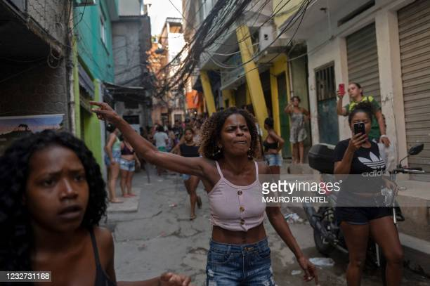 Residentes protest after a police operation against alleged drug traffickers at the Jacarezinho favela in Rio de Janeiro, Brazil, on May 06, 2021. -...