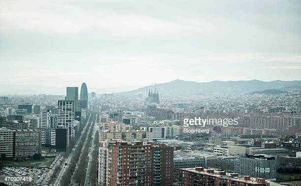 Residential and commercial buildings as well as the Sagrada Familia cathedral center stand on the city skyline of Barcelona Spain on Thursday Feb 20...