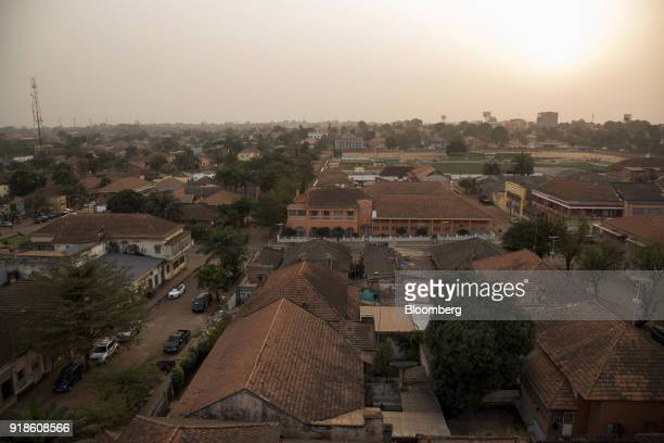 Residential and commercial buildings stand in Bissau GuineaBissau on Tuesday Feb 13 2018 The International Monetary Fund said an increase in public...