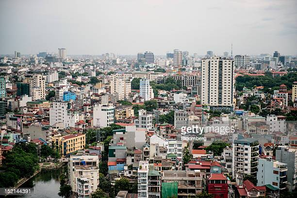 Residential and commercial buildings stand in Hanoi Vietnam on Friday Sept 14 2012 Vietnam has no need for loans from the International Monetary Fund...