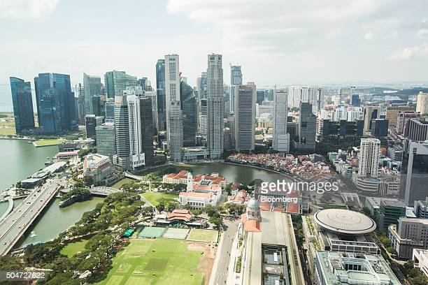 Residential and commercial buildings stand in the central business district of Singapore on Tuesday Jan 12 2016 A further slide in residential home...
