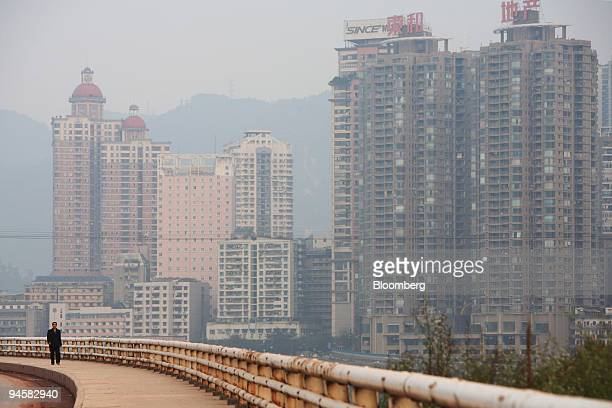 Residential and commercial buildings stand in the city of Chongqing China on Tuesday Oct 16 2007 Chongqing a municipality as well as a city is...