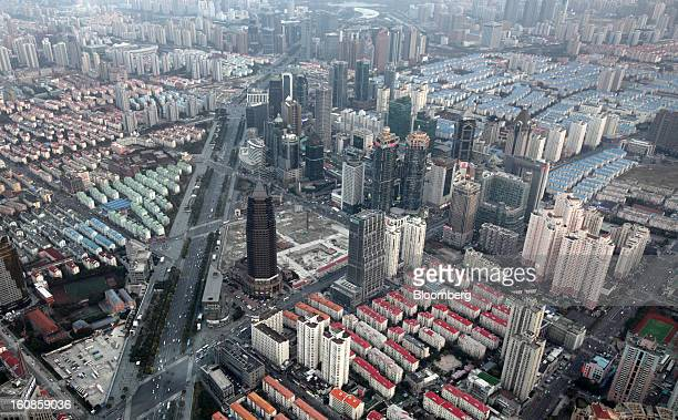 Residential and commercial buildings stand in the Pudong area of Shanghai China on Saturday Feb 2 2013 China's economic growth accelerated for the...