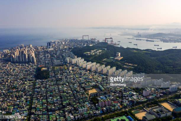 Residential and commercial buildings stand in this aerial photograph taken above Ulsan, South Korea, on Sunday, Aug. 4, 2019. Ulsan is known as...