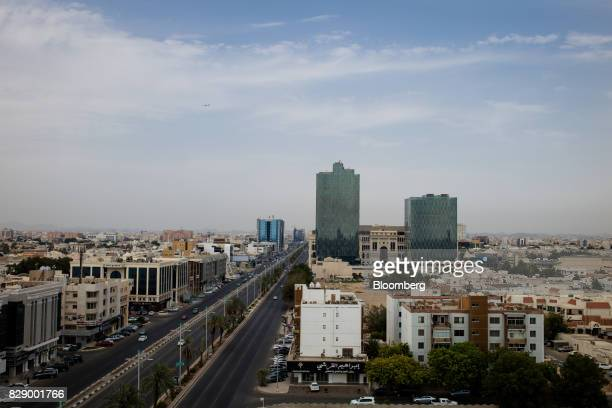 Residential and commercial properties sit on the city skyline beside a highway in Jeddah Saudi Arabia on Sunday Aug 6 2017 After relying on oil to...