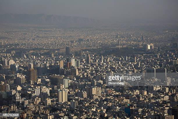 Residential and commercial properties sit on the city skyline in Tehran Iran on Tuesday Aug 25 2015 Iran's oil industry needs $100 billion to $500...