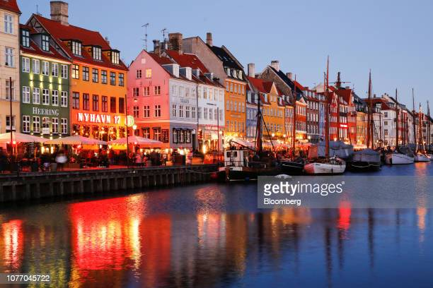 Residential and commercial properties stand on the bank of the canal in the Nyhavn district of central Copenhagen Denmark on Wednesday Jan 2 2019 For...