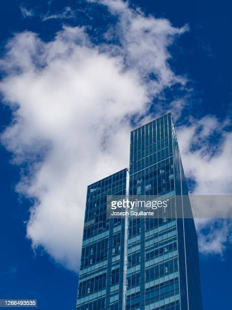 residential and office towers in blue - joseph squillante stock pictures, royalty-free photos & images
