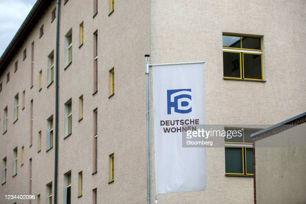 Residential apartment block and company banner on the Carl Legien modernist housing estate, operated by Deutsche Wohnen SE, in Berlin, Germany, on...