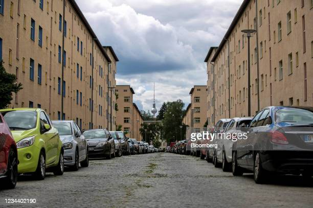 Residential apartment blocks on the Carl Legien modernist housing estate, operated by Deutsche Wohnen SE, and the Fernsehturm tower in Berlin,...