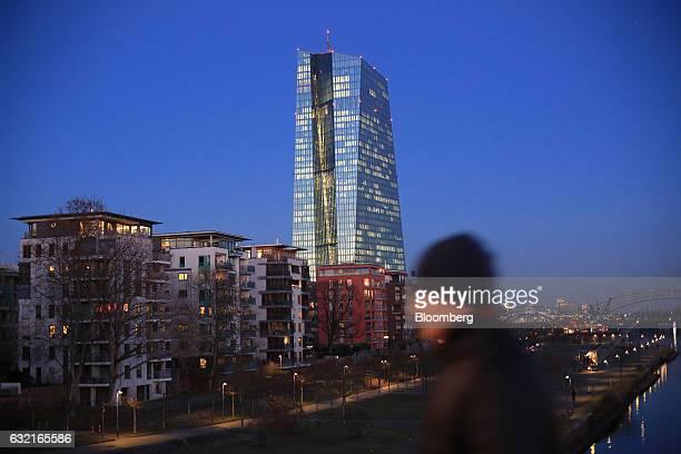 Residential apartment blocks stand beside the European Central Bank skyscraper headquarters in Frankfurt Germany on Thursday Jan 19 2017 The ECB left...