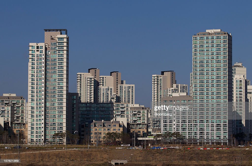 Residential apartment buildings stand in Sejong, South Korea, on Tuesday, Dec. 4, 2012. The construction of Sejong City 120 kilometers (75 miles) south of the capital fulfills the vision of the late President Roh Moo Hyun, who pledged to reduce the dominance of Seoul and pump money into a region courted for its swing voters. Photographer: SeongJoon Cho/Bloomberg via Getty Images