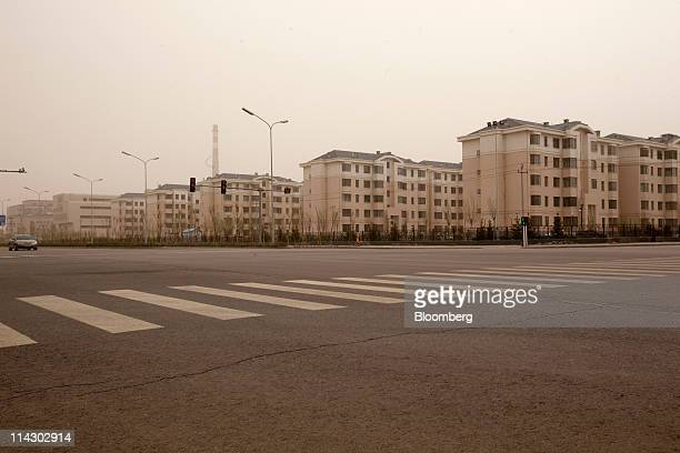 Residential apartment buildings stand in the new district of Kangbashi in Ordos Inner Mongolia China on Friday April 29 2011 Designed for 300000...