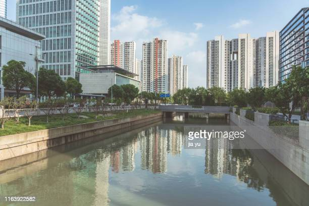 residential apartments and commercial buildings against sky - suzhou stock pictures, royalty-free photos & images