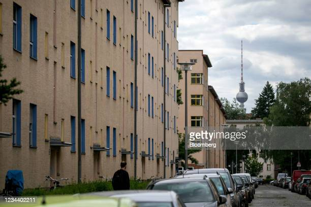 Residential apartments on the Carl Legien modernist housing estate, operated by Deutsche Wohnen SE, and the Fernsehturm tower in Berlin, Germany, on...
