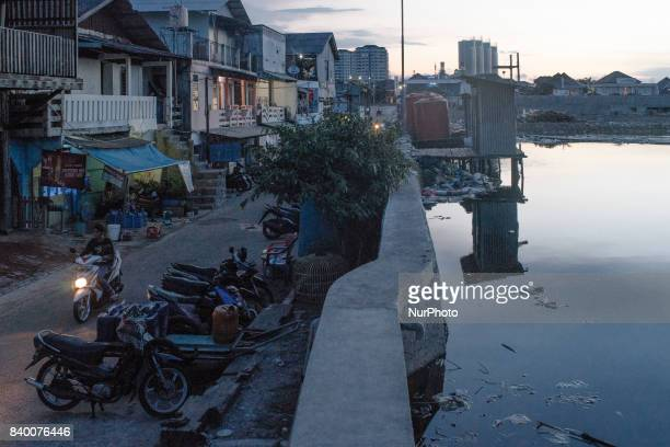 Residential area protected behind the new giant seawall in Jakarta Indonesia on August 27 2017 Governments through National Coastal Integrated...