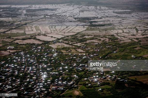 TOPSHOT Residential areas and farming fields remain flooded at the outskirts of Beledweyne Somalia on December 14 2019 The rains have inundated big...