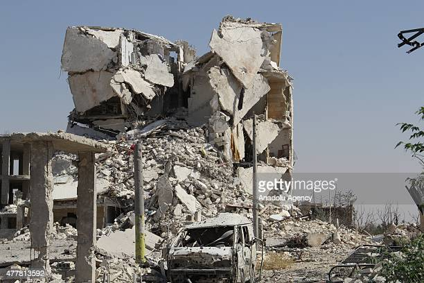 Residential areas are destroyed in a barrel bomb attack carried out by Bashar alAssad regime forces during the clashes against Syrian opponents at...
