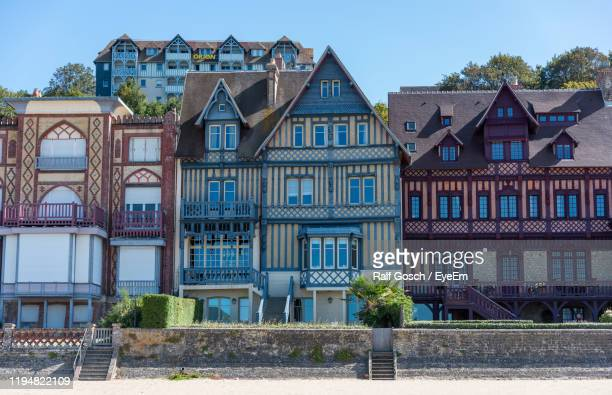 residential building against sky - trouville sur mer stock pictures, royalty-free photos & images