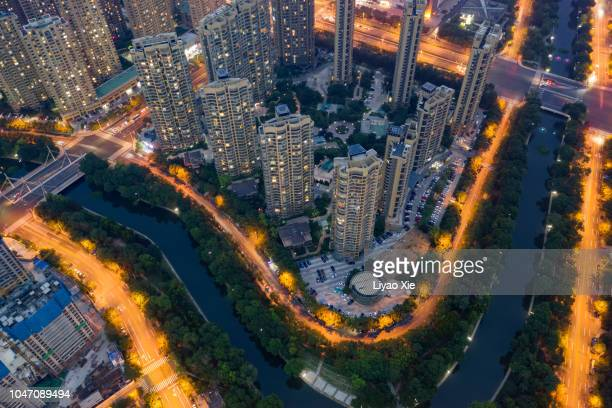 residential building along the river - liyao xie stock-fotos und bilder