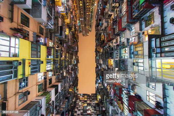 residential building at night, quarry bay, hong kong - local landmark stock pictures, royalty-free photos & images