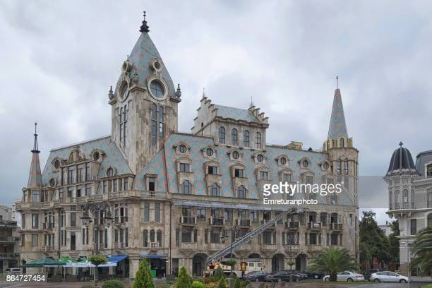 a residential building in downtown batumi with a crane in front on an overcast autumn day. - emreturanphoto stock pictures, royalty-free photos & images