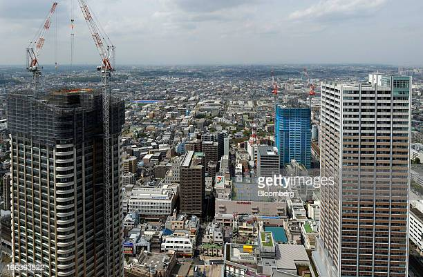 A residential building left stands under construction in Kawasaki Kanagawa Prefecture Japan on Wednesday April 10 2013 Nationwide land prices on...