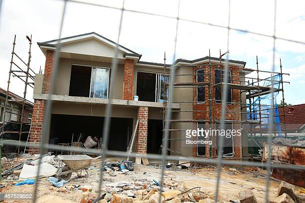 A residential building stands under construction in the suburb of Roseville in Sydney Australia on Saturday Oct 18 2014 Sydneys median home price...