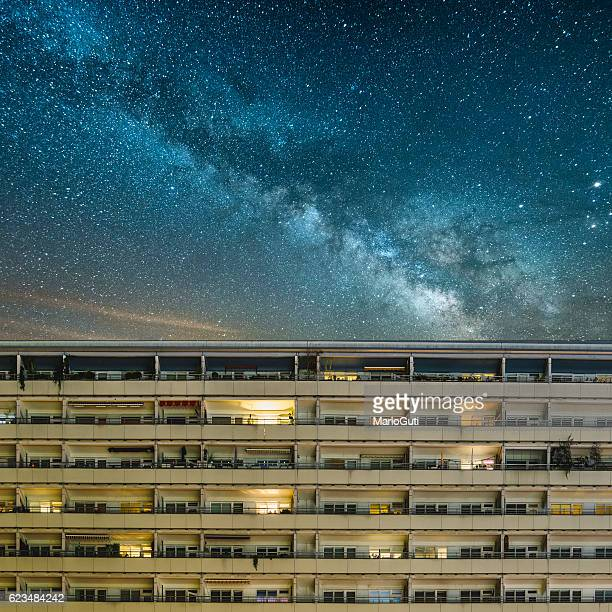 residential building under a starry sky - east berlin stock photos and pictures