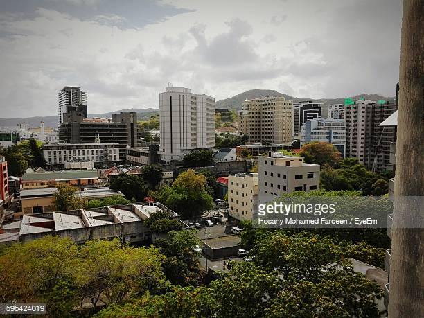 residential buildings against cloudy sky - port louis stock photos and pictures