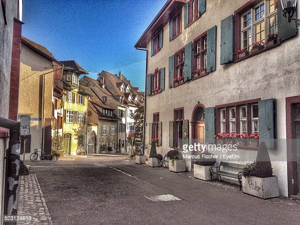 residential buildings and street at dusk - basel switzerland stock pictures, royalty-free photos & images