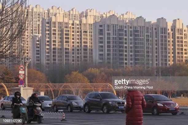 Residential buildings are pictured in Baotou city, Inner Mongolia, on Nov. 18, 2017. The metro construction in Baotou city has been suspended after...